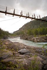 Footbridge Crossing River