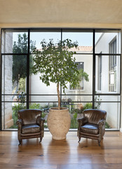 Armchairs in Front of a Large Window