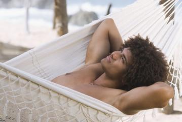 African man laying in hammock