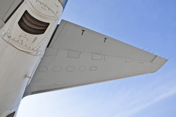 Low angle view of airplane wing against blue sky