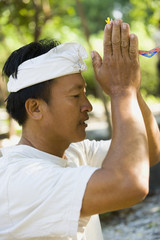 Asian man praying