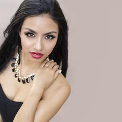 Beautiful young woman long dark hair in black dress