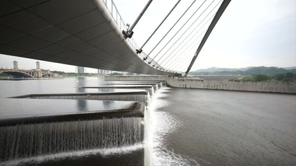 Water Flow At Putrajaya Dam Below Pedestrian Bridge