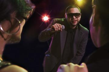 Hispanic man singing in nightclub