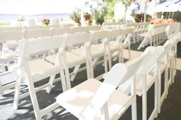Rows of White Folding Chairs