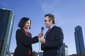 African female reporter interviewing businessman