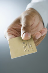 Mixed Race man holding credit card