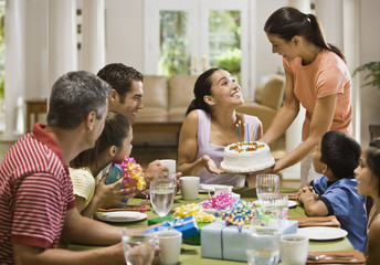 Hispanic woman celebrating birthday with family
