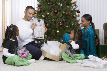 African family opening Christmas gifts