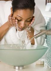 African woman washing face