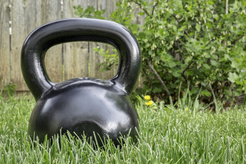 heavy iron  kettlebell in backyard