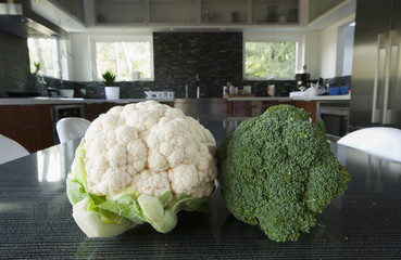 Head of Broccoli and Cauliflower on a Table