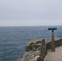 Rocky viewpoint with a telescope