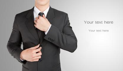 Well dressed businessman looklike smart adjusting  his neck tie