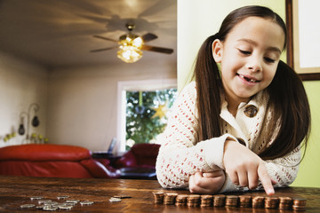 Asian girl counting coins
