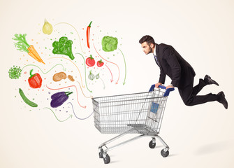 Businessman with shopping cart with vegetables