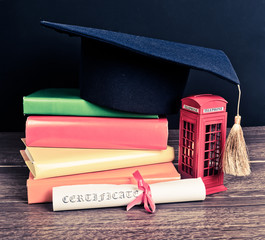 education in Great Britain Concept. Stack of books, mortarboard,