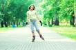 Leinwandbild Motiv Roller skating sporty girl in park rollerblading on inline skate