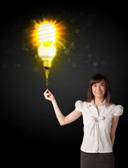 Businesswoman with an eco-friendly  bulb