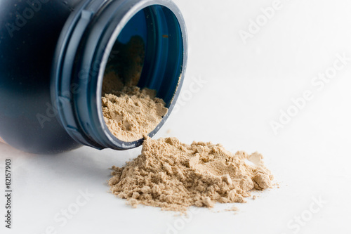 Whey protein chocolate powder isolated on white background. - 82157903