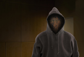 Wires in face of hooded figure