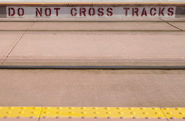 Do Not Cross Tracks sign at Light rail train station