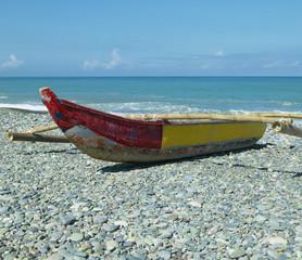 Banca Boat on a Stony Shore