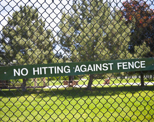 Warning Sign on Chain Fence