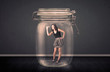 Businesswoman trapped into a glass jar concept