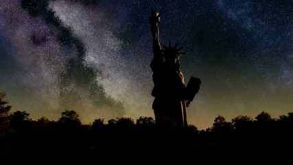 Liberty statue at sunrise from night sky