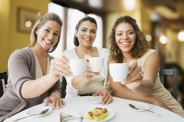 Friends enjoying coffee in cafe