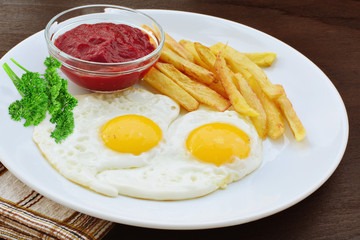 Sunny side up with fries and ketchup