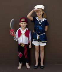 Caucasian children playing dress up