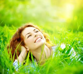 Beautiful young woman outdoors enjoying nature