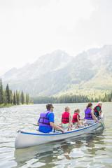 Caucasian family in canoe on lake