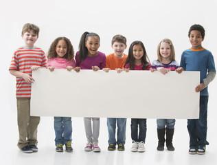 Children holding blank sign