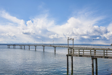 The long fishing pier at Des Moines marina extends far over Puget Sound