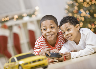 Mixed Race brothers playing with remote control car