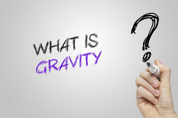 Hand writing what is gravity