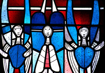 Three angels in stained glass