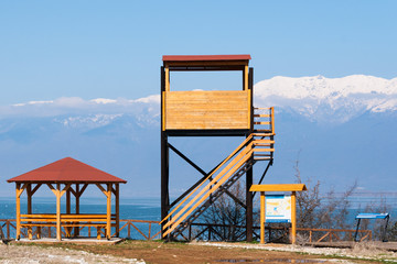 Wooden kiosk, watchtower and informative billboard at a wetland