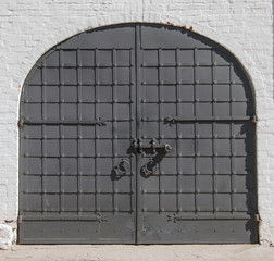 antique wrought iron gate with bolt and lock
