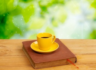 Autumn. Cup of tea with autumn leaves reflection on book on
