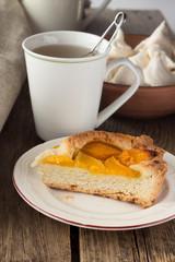 Shortcrust peach pie and cup of tea