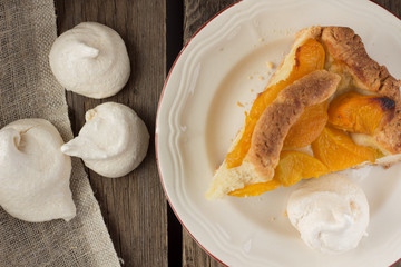 Piece of peach shortcake and meringues