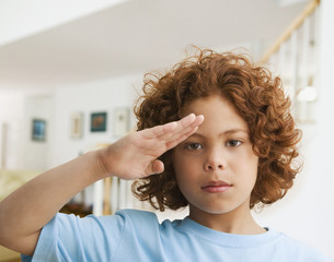 Mixed Race boy saluting
