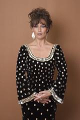 Glamorous Hispanic woman in elegant dress