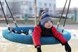 Child lying on a swing