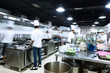 modern kitchen and busy chefs - 82169514