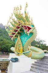 green Naga statue in temple entrance